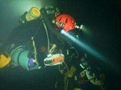 British explorer leads team to the lowest depths recorded by cavers, venturing almost a mile underground through pitch black tunnels, including 600m underwater swim